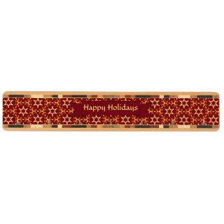 あずき色および金ゴールドの星の白熱クリスマスかハヌカー キーラック
