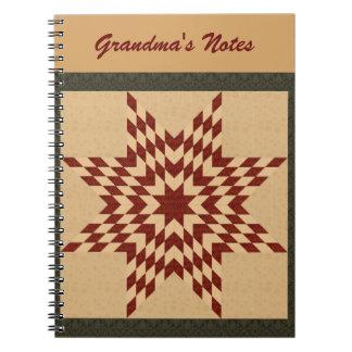 あずき色の単独星のキルトのデザイン ノートブック