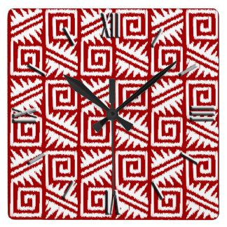 えんじ色および白いイカットのアステカなパターン- スクエア壁時計