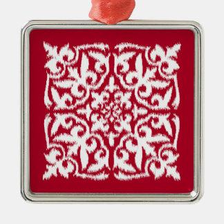 えんじ色および白いイカットのダマスク織パターン- メタルオーナメント
