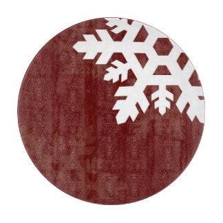 えんじ色に対する明るく、白い雪片 カッティングボード