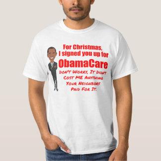 おもしろいなオバマケアのクリスマスの冗談 Tシャツ