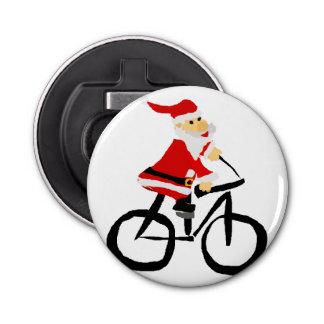 おもしろいなサンタクロースの乗馬の自転車の芸術 栓抜き