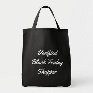 おもしろいなタイポグラフィによって金曜日の確認される黒い買物客 トートバッグ