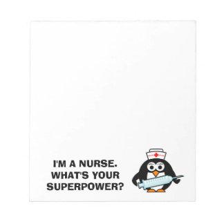 おもしろいなペンギンのナースが付いているカスタムな看護のメモ帳 ノートパッド