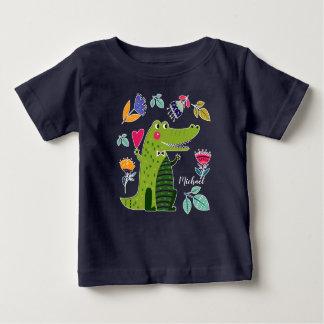 おもしろいなワニのギフトのベビーのTシャツ ベビーTシャツ