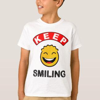 おもしろいのカラフルで幸せな微笑のスマイリー Tシャツ
