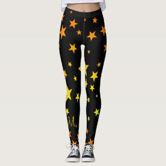 おもしろいの明るいオレンジおよび黄色の星パターン レギンス