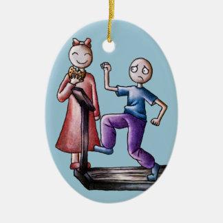 おもしろいの漫画のカップルのトレッドミルの男の子およびクッキーの女の子 セラミックオーナメント