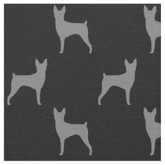 おもちゃのフォックステリア犬はパターンのシルエットを描きます ファブリック