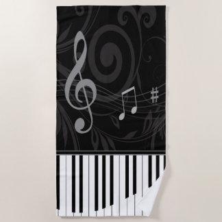 お洒落なピアノおよび音符 ビーチタオル