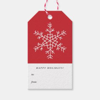 お洒落な雪片の赤く幸せなクリスマスのプレゼントのラベル ギフトタグ