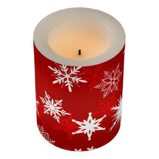 お祝いのクリスマスの雪片 LEDキャンドル