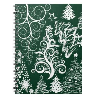 お祝いの休日の緑のクリスマスツリーのクリスマス ノートブック