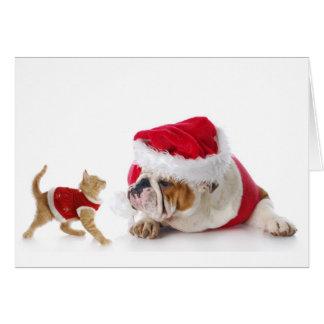 お祝いの子ネコおよびブルドッグの子犬の休日カード カード