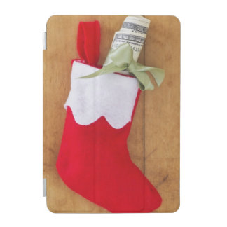 お金のロールが付いているクリスマスのストッキング iPad MINIカバー