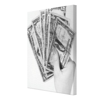 お金を握っている女性 キャンバスプリント