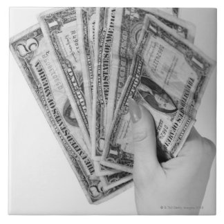 お金を握っている女性 タイル