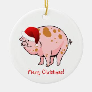 かわいいサンタの帽子のクリスマスのピンクによって斑点を付けられるブタ セラミックオーナメント