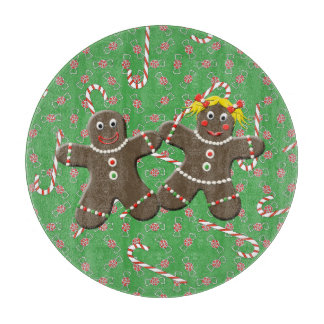 かわいいジンジャーブレッドのカップルの男の子の女の子のクリスマスのフェスティバル カッティングボード
