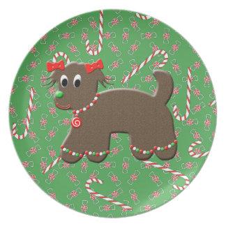 かわいいジンジャーブレッドの小犬のお祝いのクリスマスのプレート プレート