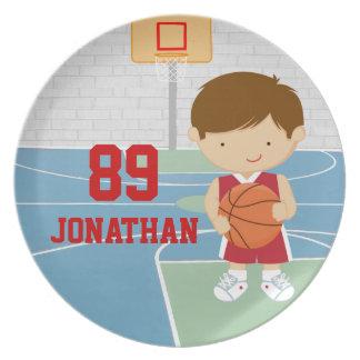 かわいいバスケットボール選手の赤いバスケットボールのjersey プレート