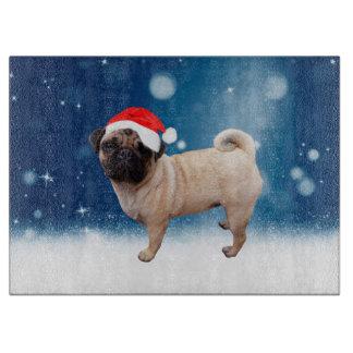 かわいいパグ犬のクリスマスのサンタの帽子の雪の星 カッティングボード