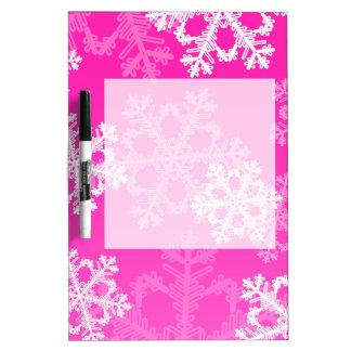 かわいいピンクおよびホワイトクリスマスの雪片 ホワイトボード