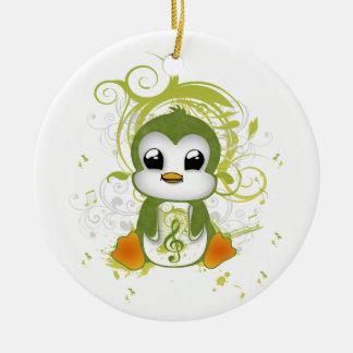 かわいいペンギンの緑の柔らかい効果音楽ノートは渦巻きます セラミックオーナメント
