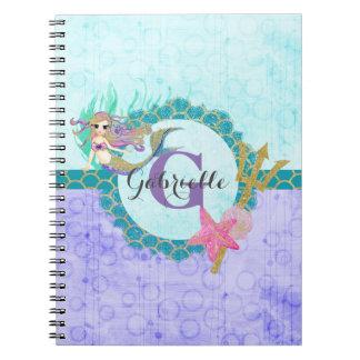 かわいいモノグラムの人魚のティール(緑がかった色)及び紫色の水彩画 ノートブック