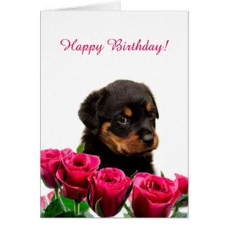 かわいいロットワイラーの子犬の赤いバラのハッピーバースデー グリーティングカード