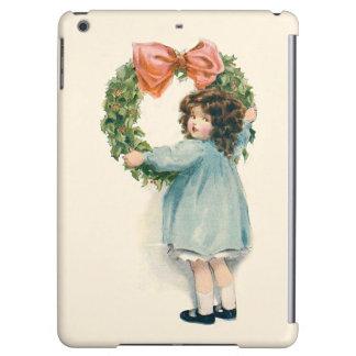 かわいい小さな女の子のヒイラギのリースのピンクの弓