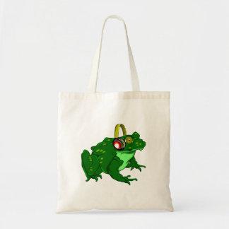 かわいい漫画のカエルの身に着けているヘッドホーン トートバッグ