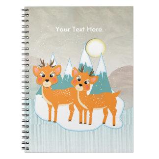 かわいい漫画のトナカイの雪場面フェスティバルのクリスマス ノートブック