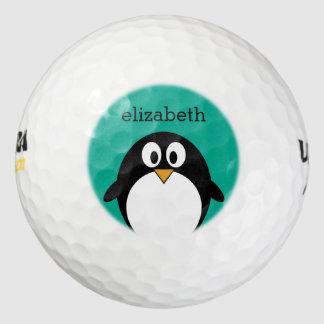 かわいい漫画のペンギンのエメラルドおよび黒 ゴルフボール