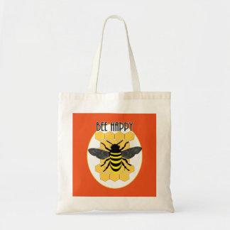 かわいい蜂の幸せなおもしろいの蜜蜂の巣ののまわりにのグラフィック トートバッグ