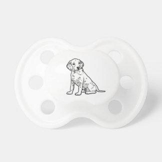 かわいいDalmatian子犬 おしゃぶり