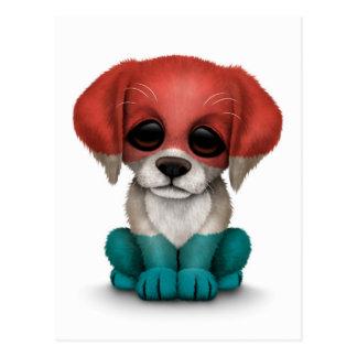 かわいく愛国心が強いルクセンブルクは白い小犬に印を付けます ポストカード