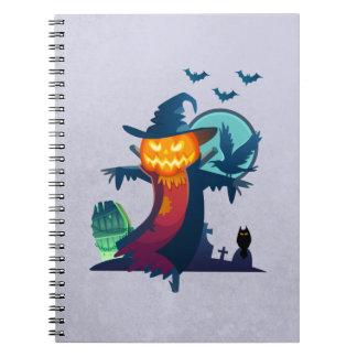 こうもりおよびカラスが付いているハロウィンの幽霊のよく出るなかかし ノートブック