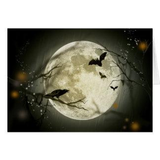 こうもりはハロウィンの満月の前にカラスを坐ります飛ばします カード
