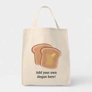 このバター付きのトーストのグラフィックをカスタマイズ トートバッグ