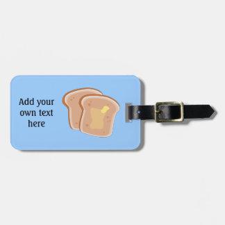 このバター付きのトーストのグラフィックをカスタマイズ ラゲッジタグ