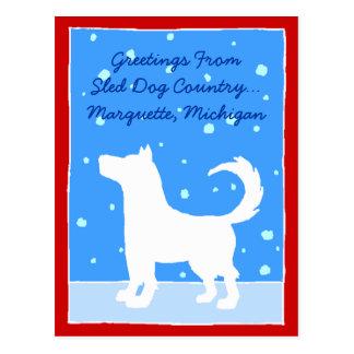 そり犬のシルエットの降雪の広告宣伝の競争の郵便はがき ポストカード