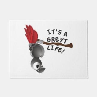 それはGreytの生命アフリカ灰色のオウムです ドアマット
