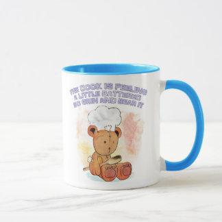 にやにや笑いおよびくま調理師のマグ マグカップ