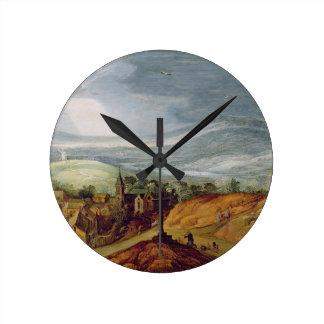 の前にひざまずいている巡礼者との田園景色 ラウンド壁時計