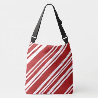 はっきりしたな全にプリントの赤く及び白いペパーミントは縞で飾ります クロスボディバッグ