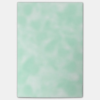 まだらにされる真新しい緑および白 ポストイット