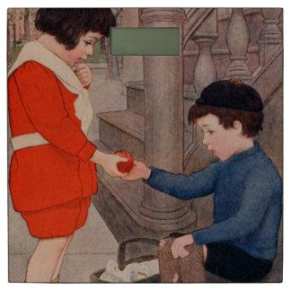 りんごを共有している2人の子供 体重計