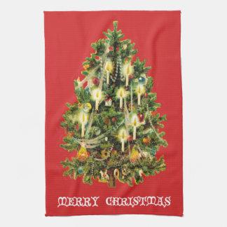 ろうそくに照らされたクリスマスツリーは花輪を飾ります キッチンタオル